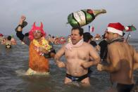 People wearing costumes participate in a traditional New Year's Day swim in Malo-les-Bains, northern France January 1, 2015. REUTERS/Pascal Rossignol (FRANCE - Tags: ANNIVERSARY SOCIETY)