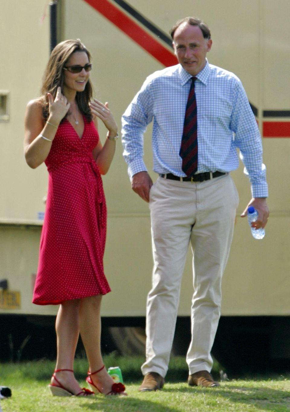 <p>With Prince William's Private Secretary Jamie Lowther-Pinkerton while watching Prince William compete in the Chakravarty Cup charity polo match at Ham Polo Club in Richmond, England.</p>