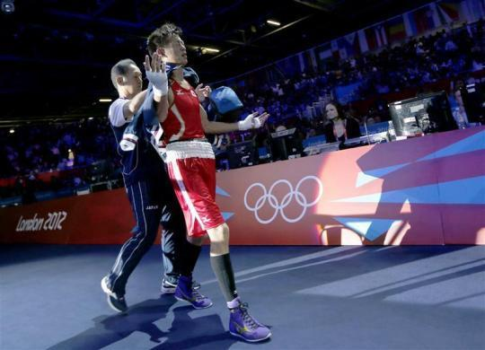 A Turkmen boxing referee and an Azerbaijani technical official were expelled from the London Olympics after a night of controversy plunged the sport back into the mire. Referee Meretnyyazov failed to stop a men's bantamweight bout evening despite fighter Magomed Abdulhamidov being knocked down by Shimizu six times in the final round. Japan's Satoshi Shimizu (R) reacts as he walks from the ring after losing to Azerbaijan's Magomed Abdulhamidov in their Men's Bantam (56kg) Round of 16 boxing match during the London 2012 Olympic Games August 1, 2012.