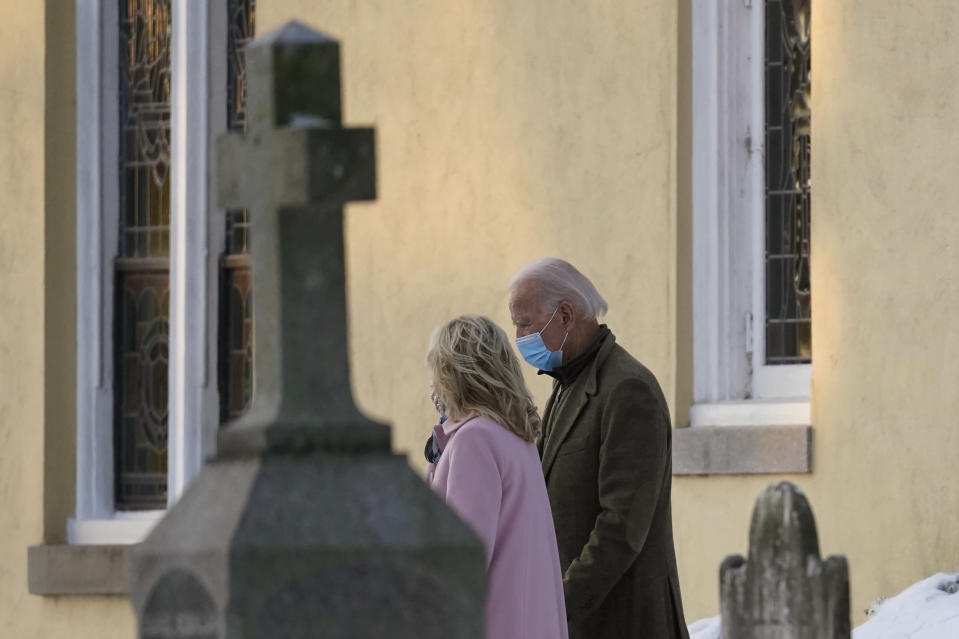 "FILE - In this Dec. 18, 2020, file photo President-elect Joe Biden and his wife Jill Biden walk from St. Joseph on the Brandywine Roman Catholic Church in Wilmington, Del. Biden says Americans should be allowed to attend church during the pandemic ""safely,"" and his transition team has underscored the importance of heeding local restrictions. Still, if he does become a regular Washington churchgoer, Biden will have plenty of choices. (AP Photo/Carolyn Kaster, File)"