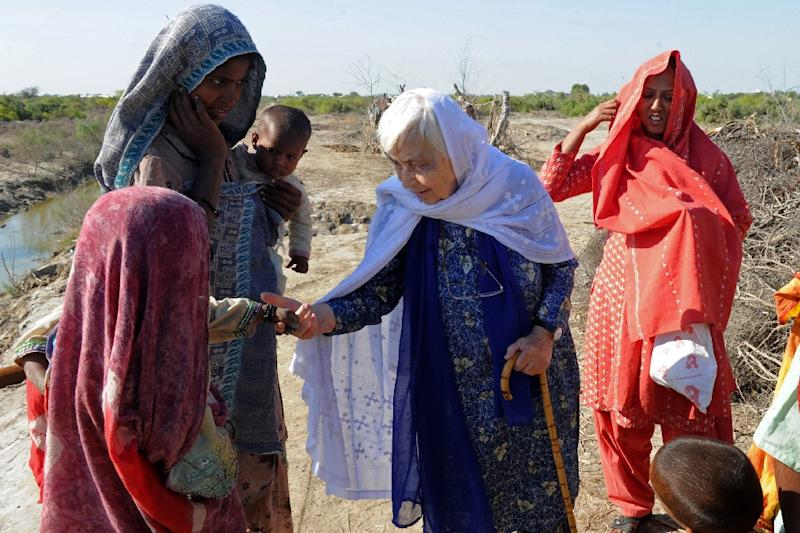 In this picture taken on December 2, 2010 Ruth Pfau (C), head of a Pakistani charity fighting leprosy and blindness, meets people in the flood-affected Begna village in southern Pakistan's Jati town