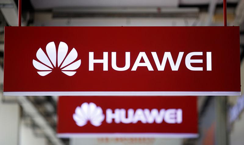 FILE PHOTO: Huawei signage are pictured at a mobile phone shop in Singapore