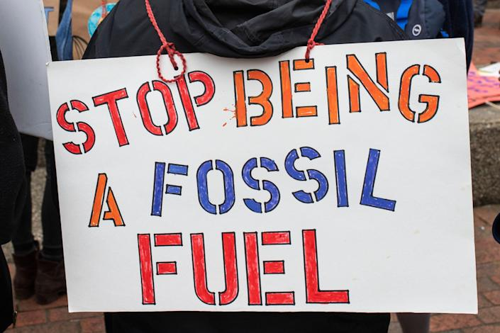 Signs opposing fossil fuels during a protest in support of the Green New Deal as well as climate and social justice on the U of L campus Friday. Feb. 22, 2019