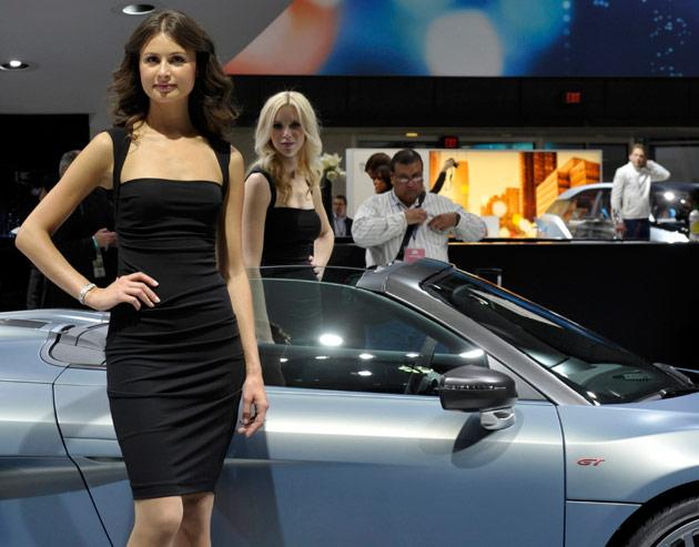 A pair of models stand in the Audi display on the first press preview day for the North American International Auto Show in Detroit, Michigan, January 9, 2012.   REUTERS/Mike Cassese