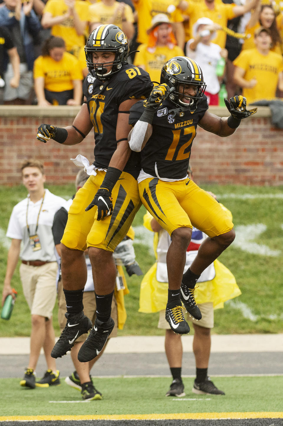 Missouri tight end Albert Okwuegbunam, left, celebrates his touchdown with teammate Johnathon Johnson during the second quarter of an NCAA college football game against South Carolina, Saturday, Sept. 21, 2019, in Columbia, Mo. (AP Photo/L.G. Patterson)