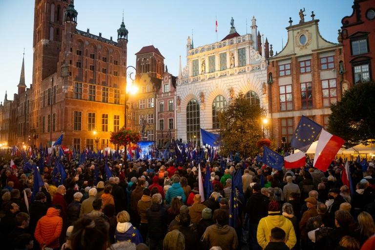 People turned out in Warsaw, Gdansk and other cities around Poland (AFP/MATEUSZ SLODKOWSKI)