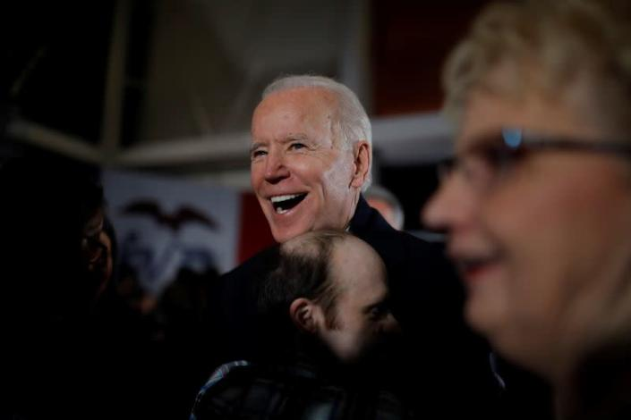 A supporter hugs Democratic 2020 U.S. presidential candidate and former Vice President Joe Biden during a campaign event in Ankeny, Iowa, U.S.
