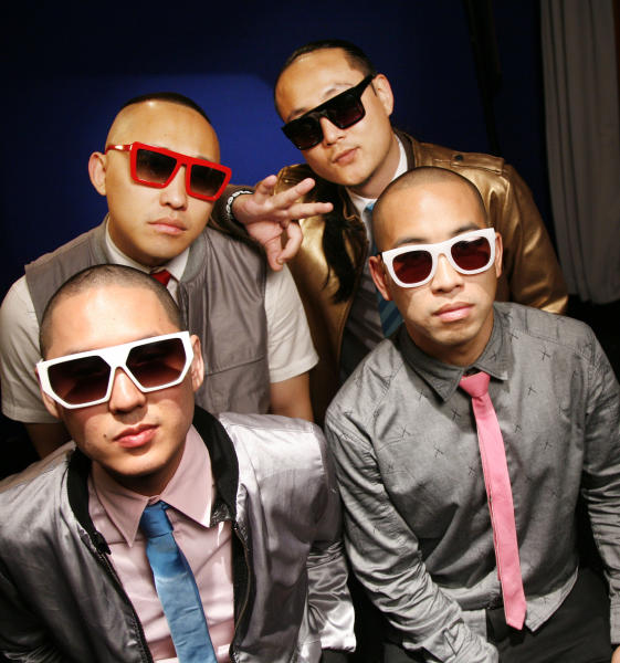 """FILE - In a Tuesday, Oct. 12, 2010 file photo, the band """"Far East Movement"""" clockwise from top left, Prohgress, J-Splif, DJ Virman and Kev Nish, pose for a portrait in New York. The group's latest album, """"Dirty Bass,"""" is set for release on June 5, 2012. (AP Photo/Jeff Christensen, File)"""
