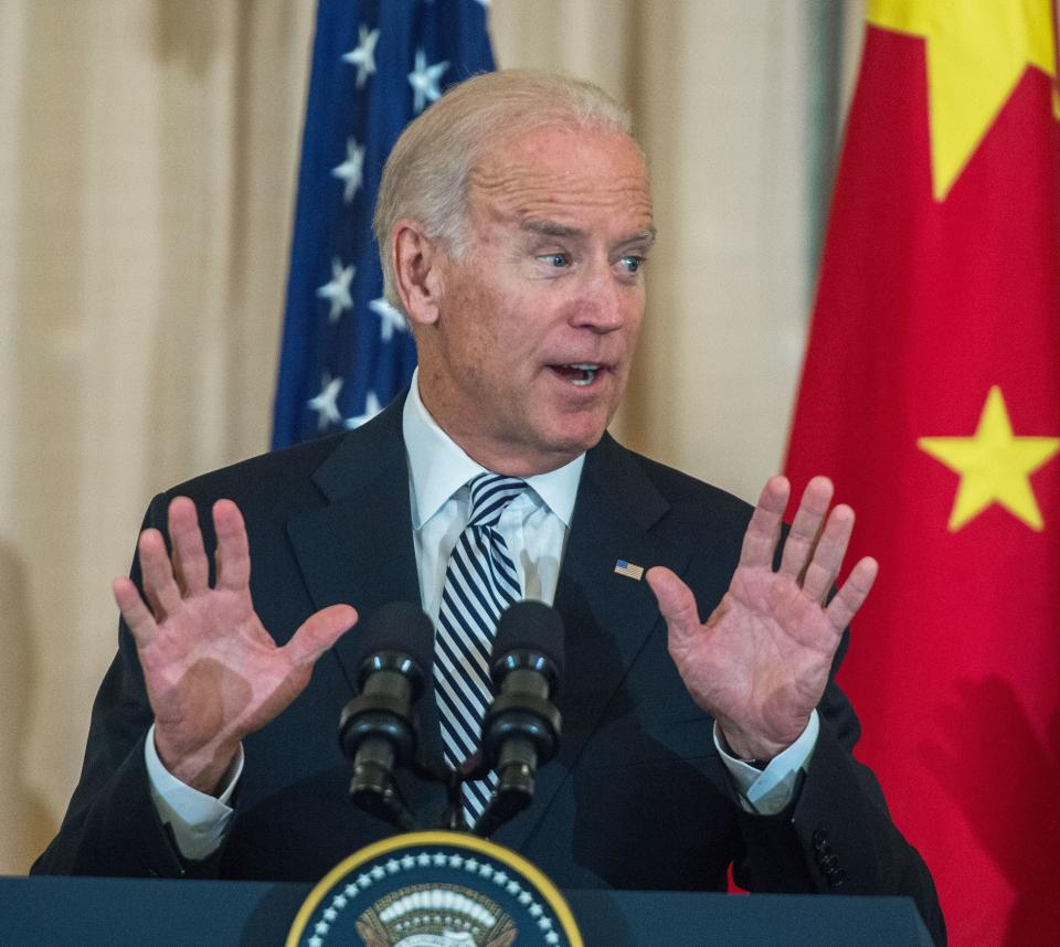 US Vice President Joe Biden signals the crowd to wait to applause as he and US Secretary of State John Kerry host a State luncheon in honor of Chinese President Xi Jinping September 25, 2015 in the Benjamin Franklin room at the Department of State in Washington, DC.              AFP PHOTO/PAUL J. RICHARDS (Photo by Paul J. RICHARDS / AFP) (Photo by PAUL J. RICHARDS/AFP via Getty Images)