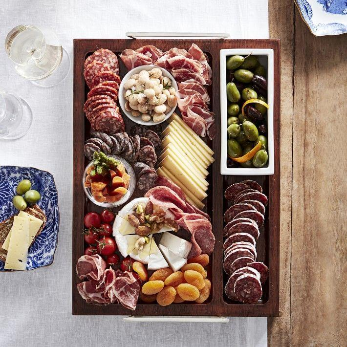 """<p>williams-sonoma.com</p><p><strong>$99.95</strong></p><p><a href=""""https://go.redirectingat.com?id=74968X1596630&url=https%3A%2F%2Fwww.williams-sonoma.com%2Fproducts%2Fmarlo-thomas-rectangle-tray&sref=https%3A%2F%2Fwww.housebeautiful.com%2Fshopping%2Fg1974%2Fhostess-gifts%2F"""" rel=""""nofollow noopener"""" target=""""_blank"""" data-ylk=""""slk:Shop Now"""" class=""""link rapid-noclick-resp"""">Shop Now</a></p><p>With its multiple compartments for cheese, charcuterie, and other snacks, this tray from <a href=""""https://www.housebeautiful.com/shopping/a35216138/marlo-thomas-williams-sonoma/"""" rel=""""nofollow noopener"""" target=""""_blank"""" data-ylk=""""slk:Marlo Thomas's debut home line"""" class=""""link rapid-noclick-resp"""">Marlo Thomas's debut home line</a> will bring your host's cheese board game to the next level. </p>"""