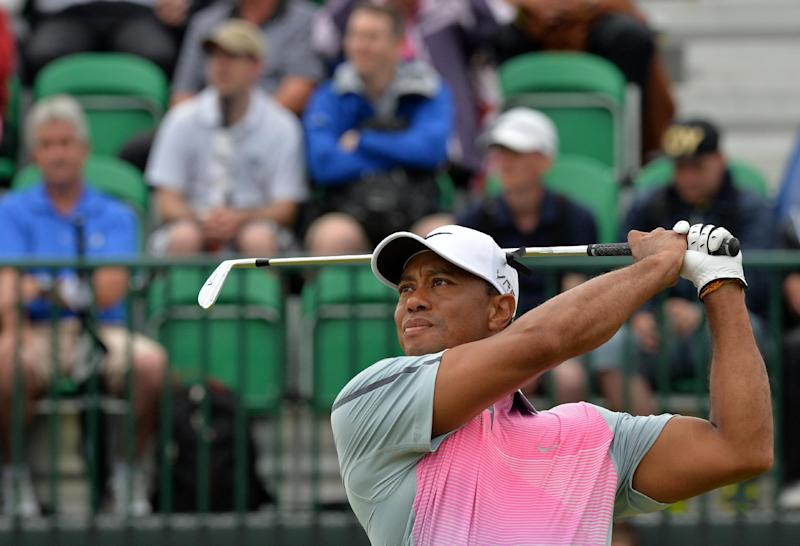 US golfer Tiger Woods watches his shot from the 9th tee during his third round 73, on day three of the British Open Golf Championship at Royal Liverpool Golf Course in Hoylake, on July 19, 2014