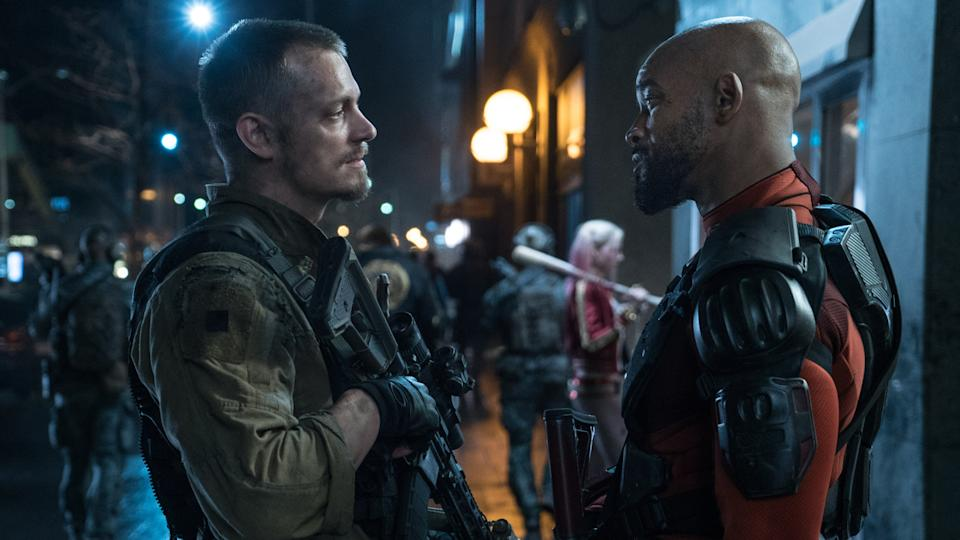 Joel Kinnaman and Will Smith in David Ayer's 2016 movie 'Suicide Squad'. (Credit: Warner Bros)
