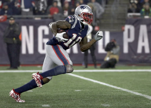 FILE - In this Dec. 2, 2018, file photo, New England Patriots wide receiver Josh Gordon runs for a touchdown after catching a pass during the second half of an NFL football game against the Minnesota Vikings in Foxborough, Mass. The Patriots arent ready to give up on the possibility of Gordon playing football again in New England. The team extended qualifying offers to the restricted free agent receiver as well as defensive back Jonathan Jones on Wednesday, March 13. Gordon could rejoin New England only if hes reinstated from his latest suspension for violating an agreement that allowed him to play after multiple drug suspensions. (AP Photo/Elise Amendola, File)
