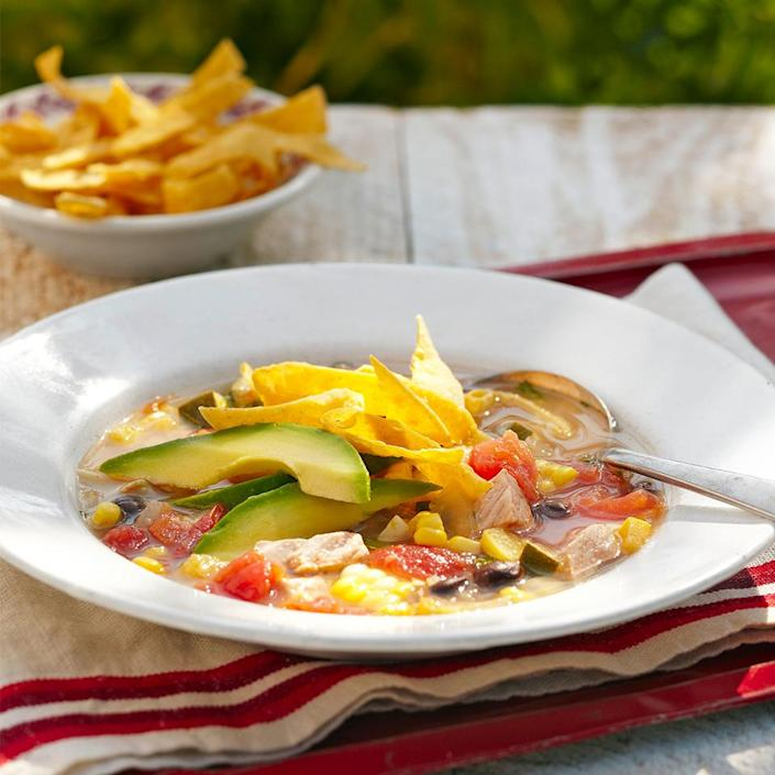 <p>Take advantage of local fresh corn and whip up this 40-minute Mexican-inspired summer soup recipe. It's topped with creamy avocado slices and crispy corn tortillas, but you can make it next-level by adding a dollop of nonfat plain yogurt, a bit of grated Cheddar, and/or chopped scallions.</p>