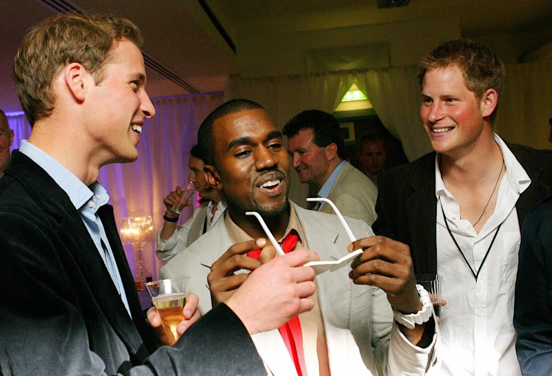 Kanye West shares a joke with Prince Harry and Prince William at Wembley Arena in London, 2007. Photo by CARL DE SOUZA/AFP/Getty Images.