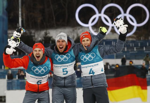 Nordic Combined Events - Pyeongchang 2018 Winter Olympics - Men's Individual 10 km Final - Alpensia Cross-Country Skiing Centre - Pyeongchang, South Korea - February 20, 2018 - Gold medalist, Johannes Rydzek of Germany, silver medalist, Fabian Riessle of Germany and bronze medalist Eric Frenzel of Germany celebrate during the victory ceremony. REUTERS/Kai Pfaffenbach