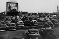 <p>Cars gather to watch an outdoor from inside their cars at the Whitestone Bridge Drive-in Movie Theater in the Bronx on June 20, 1951.</p>
