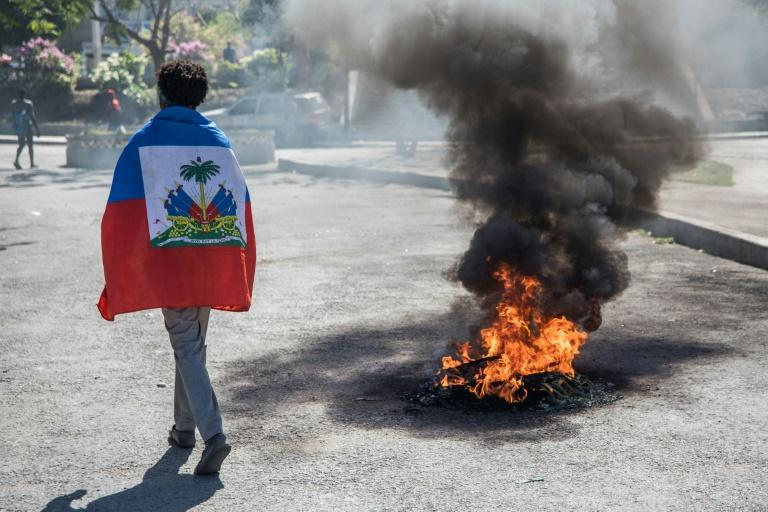 Haiti's political crisis intensified on Sunday, as the opposition claimed President Jovenel Moise's term had expired