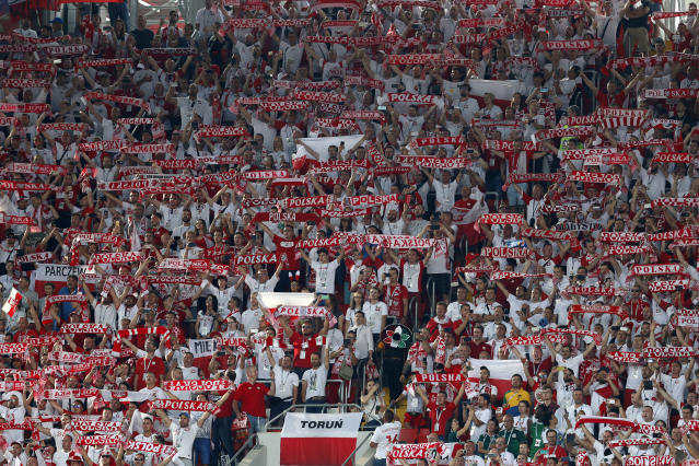 Poland soccer fans sing their national anthem prior to the start of the group H match between Poland and Senegal at the 2018 soccer World Cup in the Spartak Stadium in Moscow, Russia, Tuesday, June 19, 2018. (AP Photo/Eduardo Verdugo)