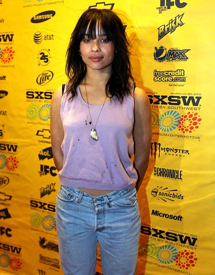 "What is wrong with these celebs?! Zoe Kravitz opted for a mangy cropped vest and '80s-esque denim for the premiere of her film ""Yelling to the Sky."" Can't she afford a top sans holes ... or a mirror? Yikes! Hutton Supancic/<a href=""http://www.wireimage.com"" target=""new"">WireImage.com</a> - March 13, 2011"