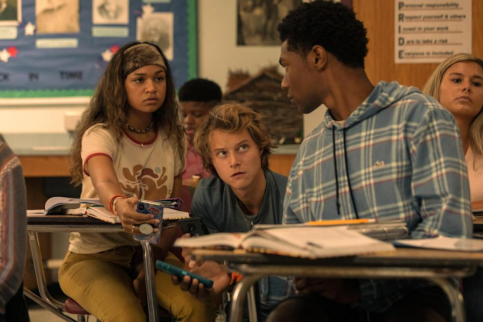 OUTER BANKS (L to R) MADISON BAILEY as KIARA, RUDY PANKOW as JJ and JONATHAN DAVISS as POPE in episode 201 of OUTER BANKS Cr. JACKSON LEE DAVIS/NETFLIX © 2021