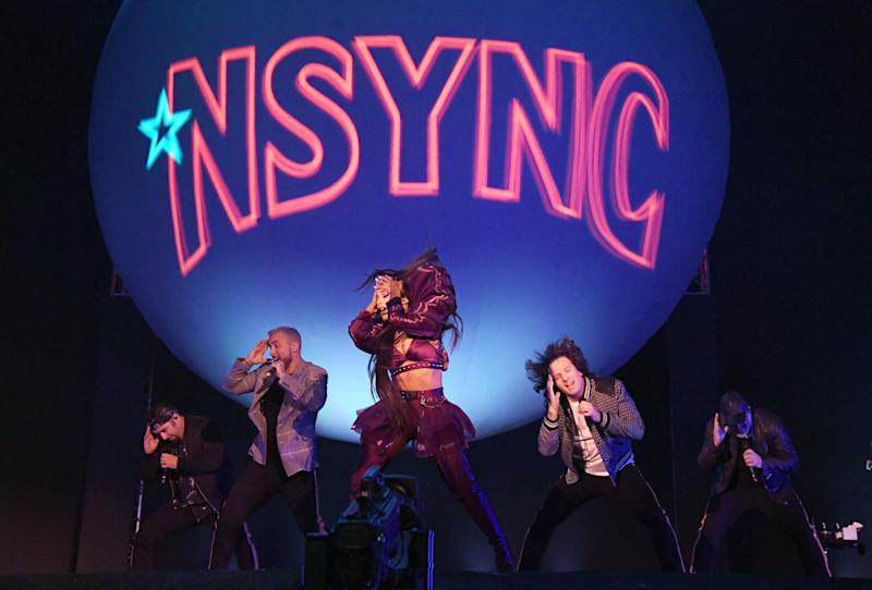 Ariana Grande performing with NSYNC members Chris Kirkpatrick, Lance Bass, JC Chasez and Joey Fatone during her headlining set at the 2019 Coachella Valley Music And Arts Festival on April 14, 2019.