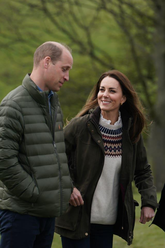 Duke and Duchess of Cambridge walk together at Manor Farm
