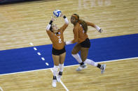 Texas' Jhenna Gabriel (2) sets the ball for Asjia O'Neal (7) against during the first set against Wisconsin in a semifinal in the NCAA women's volleyball championships Thursday, April 22, 2021, in Omaha, Neb. (AP Photo/John Peterson)