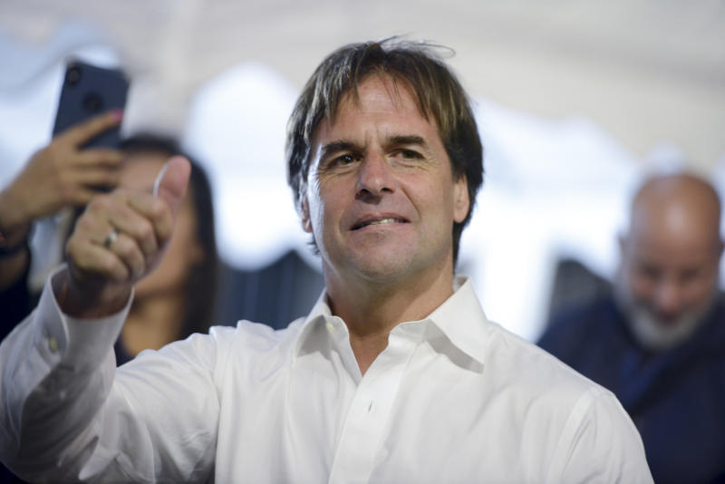 Opposition presidential candidate Luis Lacalle Pou makes a thumb up after a runoff elections in Montevideo, Uruguay, Sunday, Nov. 24, 2019. Uruguayans are choosing between Presidential candidate for the ruling party Broad Front Daniel Martinez and Lacalle. (AP Photo/Santiago Mazzarovich)