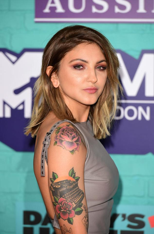"<p>You can't say singer-songwriter Julia Michaels didn't warn us. Her breakout single ""<a rel=""nofollow"" href=""https://www.youtube.com/watch?v=9Ke4480MicU"">Issues</a>"" lays out some of her messiest ones right in the song, then follows up with a threat. ""Don't judge me or I'll judge you too,"" Michaels vows. Small wonder Michaels's song has become the lay-it-on-the-line anthem of the year. The singer's quirky vocal, a passive-aggressive yelp, surely didn't hurt her in snagging attention, nor does the song's off-kilter beat. Nearly all the cuts on Michaels's seven-song debut EP, <i>Nervous System</i>, pivot on stop-start rhythms and elastic vocals. It's refreshing to hear such an individual voice for an artist previously known for molding material for others. Over the past four years, the 23-year-old has penned pieces for everyone from Fifth Harmony to Justin Bieber while also forging special bonds with Gwen Stefani and Selena Gomez, resulting in scores of pieces for, or with, them. Like Sia, Michaels has used a wealth of experience channeling the emotions of others to find a voice very much her own. (Photo: Getty Images) </p>"
