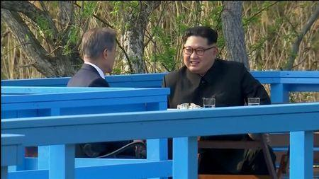 South Korean President Moon Jae-in and North Korean leader Kim Jong Un talk during the inter-Korean summit at the truce village of Panmunjom, in this still frame taken from video, South Korea April 27, 2018. Host Broadcaster via REUTERS TV