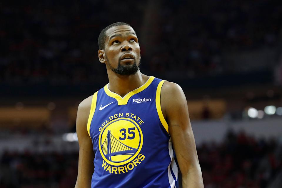 HOUSTON, TX - MAY 04:  Kevin Durant #35 of the Golden State Warriors looks toward the scoreboard in the second quarter during Game Three of the Second Round of the 2019 NBA Western Conference Playoffs against the Houston Rockets at Toyota Center on May 4, 2019 in Houston, Texas.  NOTE TO USER: User expressly acknowledges and agrees that, by downloading and or using this photograph, User is consenting to the terms and conditions of the Getty Images License Agreement.  (Photo by Tim Warner/Getty Images)
