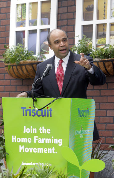 In this Tuesday, April 12, 2011 file photo Adolfo Carrion Jr., regional administrator of the U.S. Department of Housing and Urban Development, speaks at Triscuit Crackers 'Home Farming Day' celebration in New York's Madison Square Park. It sounds like a mismatch: a son of an illustrious Republican president supporting a Democrat-turned-independent, ex-Obama administration official in his quest to run for New York City mayor on the GOP line. But Michael Reagan is urging city Republican leaders to give Adolfo Carrion Jr. permission to run in the primary, saying it would strike a note of openness and diversity for a party that's grappling with how to attract Hispanic voters. (Jason DeCrow/AP Images for Kraft Foods)