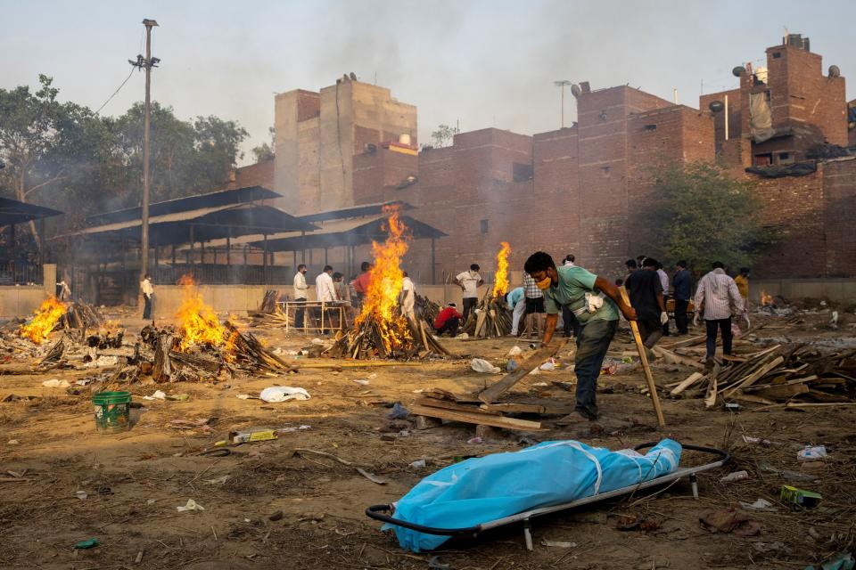 A man prepares a funeral pyre at a crematorium ground in New Delhi, India, on April 22.