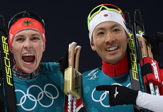 Nordic Combined Events – Pyeongchang 2018 Winter Olympics – Men's Individual 10km Final – Alpensia Cross-Country Skiing Centre - Pyeongchang, South Korea – February 14, 2018 - Eric Frenzel of Germany and Akito Watabe of Japan celebrate after the finish line. REUTERS/Carlos Barria