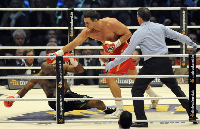 Heavyweight world boxing champion Wladimir Klitschko of Ukraine, right, knocks out Jean-Marc Mormeck of France in the fourth round of their WBA, IBF, WBO and IBO title bout in Duesseldorf, Germany, Saturday, March 3, 2012. (AP Photo/Martin Meissner)
