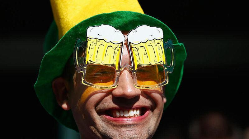 Man smiling wearing glasses shaped to look like beer goggles