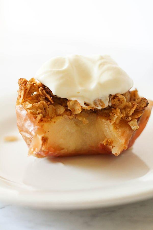 """<p>Use your air fryer to get all of the flavors of an apple pie in a hand-held dessert! These air fryer baked apples are a great way to start fall cooking.</p><p><strong>Get the recipe at <a href=""""https://www.cookitrealgood.com/air-fryer-baked-apples/"""" rel=""""nofollow noopener"""" target=""""_blank"""" data-ylk=""""slk:Cook It Real Good"""" class=""""link rapid-noclick-resp"""">Cook It Real Good</a></strong>. </p>"""