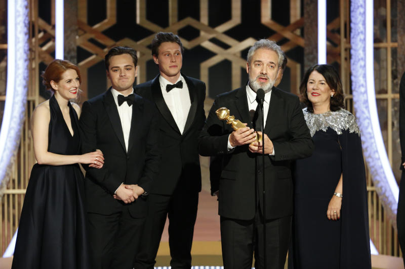 "BEVERLY HILLS, CALIFORNIA - JANUARY 05: In this handout photo provided by NBCUniversal Media, LLC, Sam Mendes accepts the award for BEST MOTION PICTURE - DRAMA for ""1917"" onstage, with Dean-Charles Chapman, George MacKay and Pippa Harris, during the 77th Annual Golden Globe Awards at The Beverly Hilton Hotel on January 5, 2020 in Beverly Hills, California. (Photo by Paul Drinkwater/NBCUniversal Media, LLC via Getty Images)"