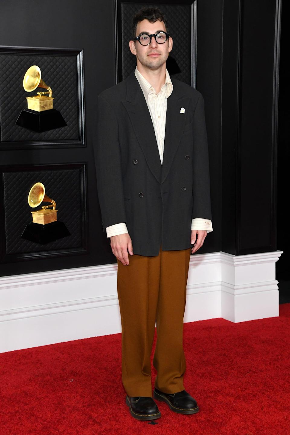 <p>Wearing a black blazer over chocolate brown pants with loafers.</p>