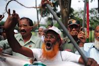 Former Bangladeshi militants -- who fought against Pakistan in the 1971 war -- demonstrate against the verdict on Mohammad Kamaruzzaman outside the International Crimes Tribunal court in Dhaka, on May 9, 2013. A Bangladeshi court has sentenced a top Islamist to death for masterminding the slaughter of at least 120 farmers in one of the bloodiest single episodes of the 1971 independence war
