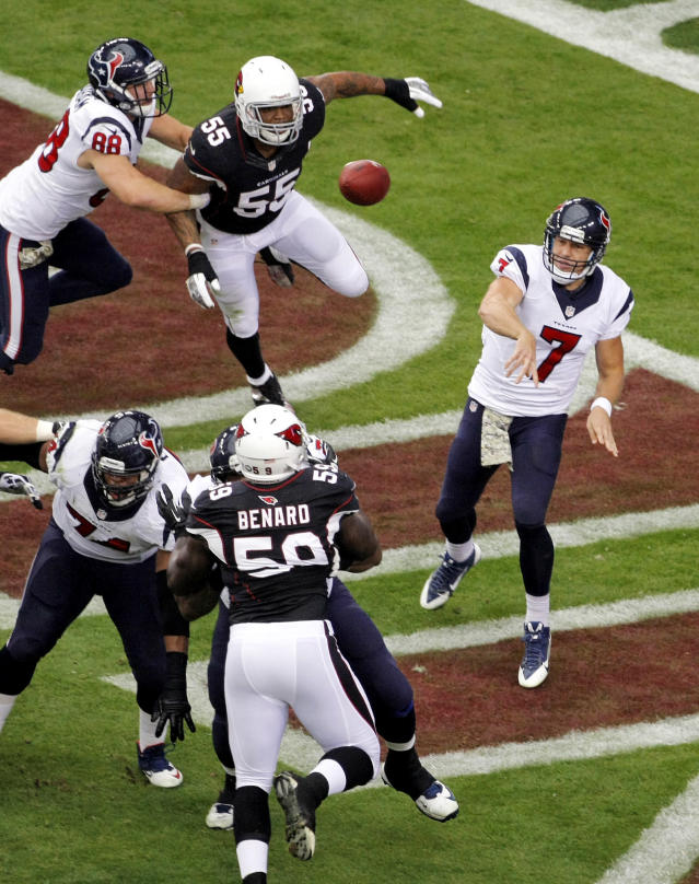 Houston Texans quarterback Case Keenum (7) throws under pressure from Arizona Cardinals outside linebacker John Abraham (55) and Marcus Benard (59) during the first half of an NFL football game Sunday, Nov. 10, 2013, in Glendale, Ariz. (AP Photo/Rick Scuteri)
