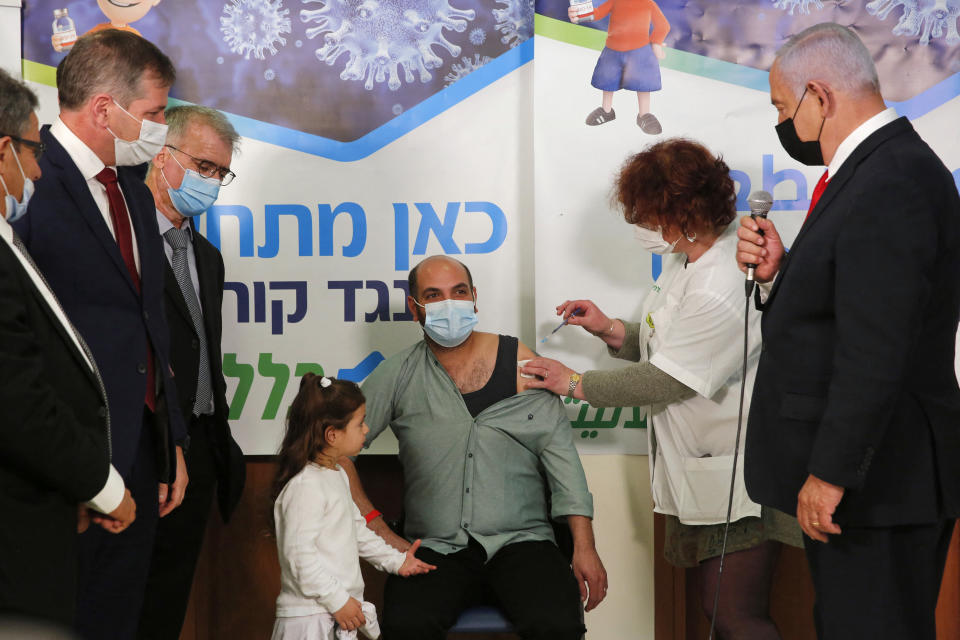 Israeli Prime Minister Benjamin Netanyahu (C) speaks during a visit at Clalit Health Service as an Israeli citizen receives a shot of the Covid-19 vaccine, in an Arab-Israeli village of Abu Ghosh near Jerusalem on March 9, 2021. (Photo by GIL COHEN-MAGEN / AFP) (Photo by GIL COHEN-MAGEN/AFP via Getty Images)