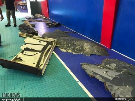 The purported wreckage of the American drone is seen displayed by the Islamic Revolution Guards Corps (IRGC) in Tehran