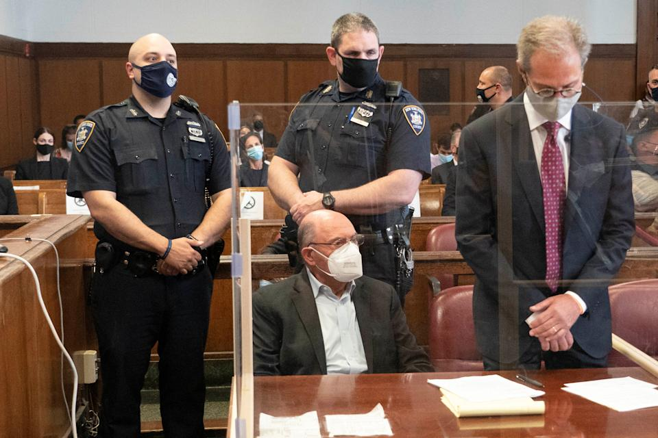 Trump Organization chief financial officer Allen Weisselberg (seated) appears for his arraignment hearing in New York.