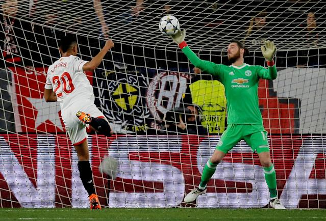 Soccer Football - Champions League Round of 16 First Leg - Sevilla vs Manchester United - Ramon Sanchez Pizjuan, Seville, Spain - February 21, 2018 Manchester United's David De Gea makes a save from Sevilla's Luis Muriel REUTERS/Jon Nazca