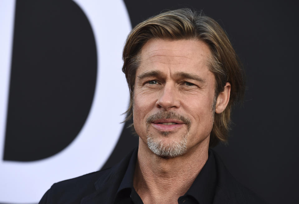 """Brad Pitt arrives at the special screening of """"Ad Astra"""" at ArcLight Cinemas on Wednesday, Sept. 18, 2019, in Los Angeles. (Photo by Jordan Strauss/Invision/AP)"""