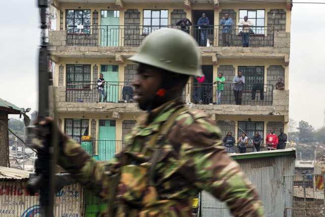 <p>Residents watch from their balconies as Kenyan security forces chase supporters of Kenyan opposition leader and presidential candidate Raila Odinga who demonstrate in the Mathare area of Nairobi Wednesday Aug. 9, 2017. Odinga alleges that hackers manipulated the Tuesday election results which appear to show President Uhuru Kenyatta has a wide lead over Odinga. (Photo: Jerome Delay/AP) </p>