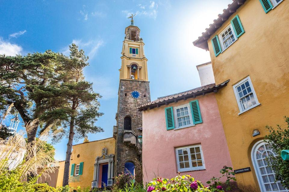 """<p><strong>Looks like: </strong>The Amalfi Coast, Italy</p><p>The ever-enchanting village of Portmeirion in Wales was built by architect Clough Williams-Ellis between 1925 and 1975 in the style of an Italian village. Its colourful buildings, cobbled stone streets and central piazza make it look typical of the pretty destinations found on the Amalfi Coast - albeit slightly cooler in temperature. Situated by the mountains of Meirionnydd, Portmeirion sits on its private peninsula overlooking the Dwyryd estuary.</p><p><strong>Stay at: </strong><a href=""""https://portmeirion.wales/stay"""" rel=""""nofollow noopener"""" target=""""_blank"""" data-ylk=""""slk:The Portmeirion Hotel"""" class=""""link rapid-noclick-resp"""">The Portmeirion Hotel</a> perched on the edge of the estuary, or stay in one of t<a href=""""https://portmeirion.wales/stay/accommodation/self-catering-cottages"""" rel=""""nofollow noopener"""" target=""""_blank"""" data-ylk=""""slk:he picturesque self-catering cottages"""" class=""""link rapid-noclick-resp"""">he picturesque self-catering cottages</a> based in the village.</p>"""