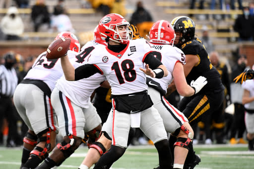 Georgia quarterback JT Daniels throws during the first half of an NCAA college football game against Missouri Saturday, Dec. 12, 2020, in Columbia, Mo. Cincinnati's Desmond Ridder is known for his dual-threat skills. JT Daniels has used his arm strength to add balance to Georgia's attack. The two quarterbacks also boast impressive football intelligence, and that may be the biggest reason neither has lost a game as a starter this season as they prepare to meet in Friday's Peach Bowl.(AP Photo/L.G. Patterson)